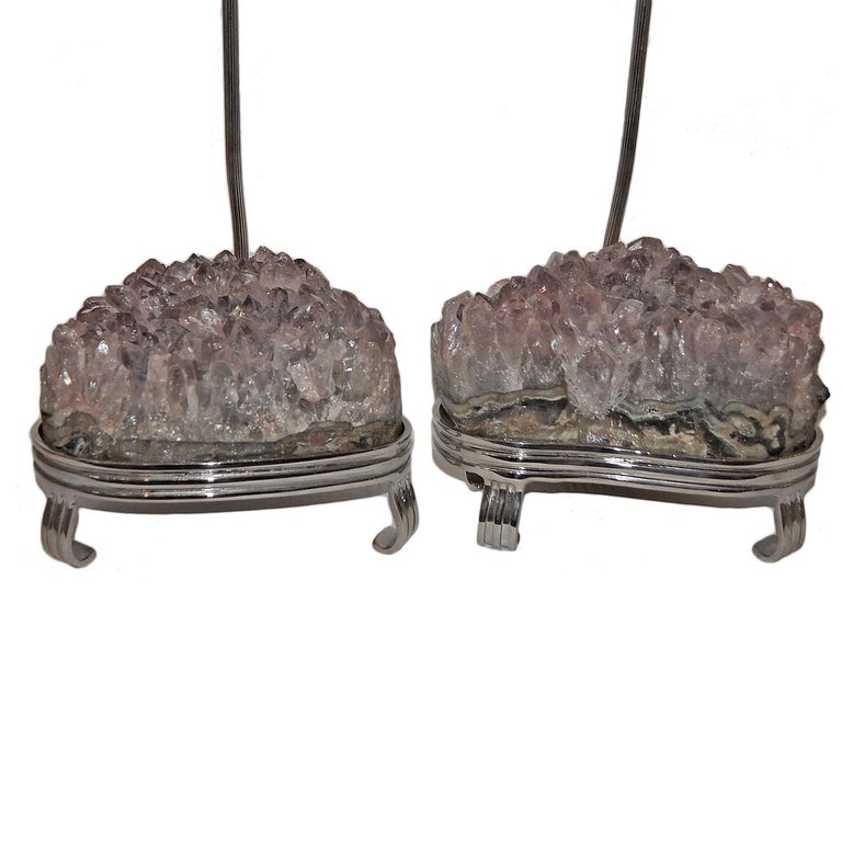A pair of circa 1960's silver finish Italian table lamps with amethyst stones.  Measurements: Height to shade rest: 35