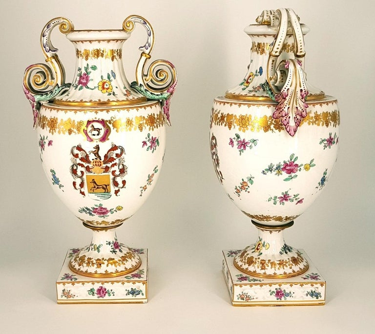 Pair of white crater vases in glazed, gilded and decorated terracotta with landscapes realized in the 19th century.  Very good conditions.  This artwork is shipped from Italy. Under existing legislation, any artwork in Italy created over 70