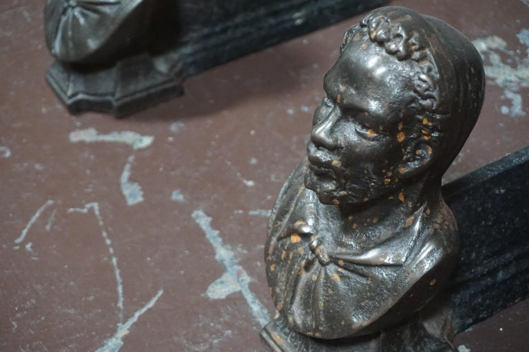 Pair of andirons cast in the likeness of a bearded man  circa 1860  Measurements:  9