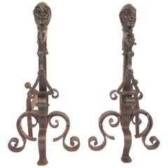 Pair of Andirons with Bronze Jester Faces