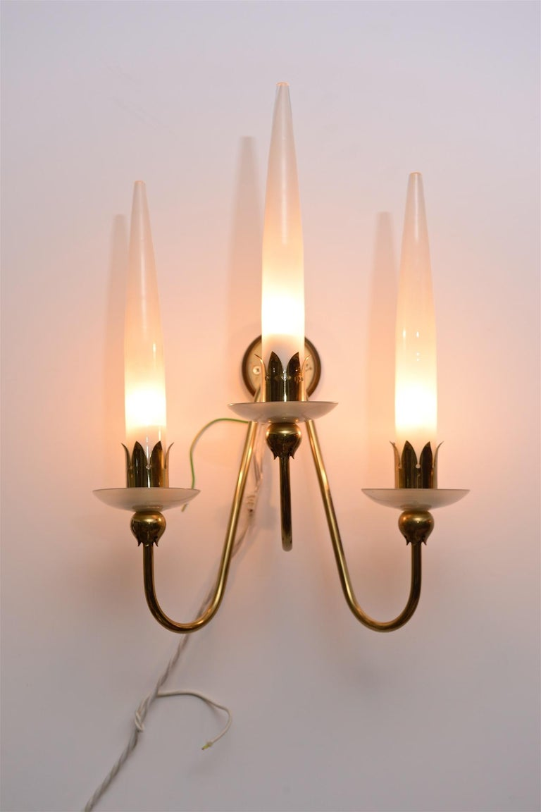 An elegant pair of Angelo Lelli for Arredoluce candelabra style wall lights in brass and milk glass.