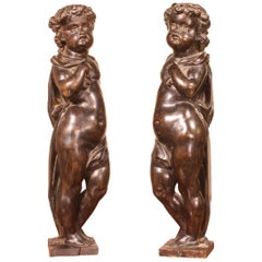 Pair of Angels in Walnut, Early 19th Century
