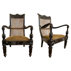 Pair of Anglo-Indian Carved Ebony and Caned Armchairs