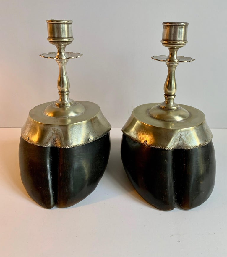 Handsome pair of hoof candlesticks with silver plate details... a perfect compliment to any mantel (fireplace) or dinner table, especially in the rustic room or cabin, but great for the modern space as well! Wonderfully made and detailed.