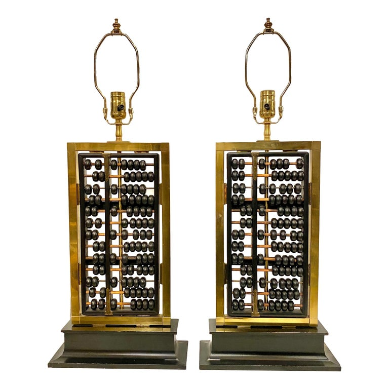 Pair of 1940s Chinese abacus mounted as lamps with bronze details.  Measures: Height of body 20