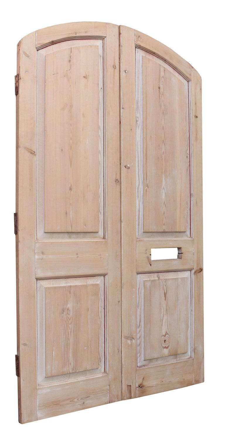 Gothic Pair of Antique Arched Pine Exterior Doors For Sale
