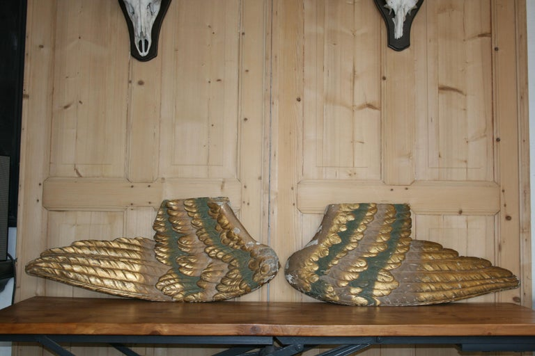 A pair of large original Baroque angel wings, hand carved from wood and giltwood. Original condition with old patina. From southern Germany.