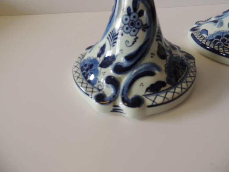 Pair of antique blue and white Delft candlesticks. Candleholders. Floral design circa 1875 Size: 5.5