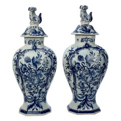 Pair of Antique Blue and White Dutch Delft Garniture Vases or Covered Urns