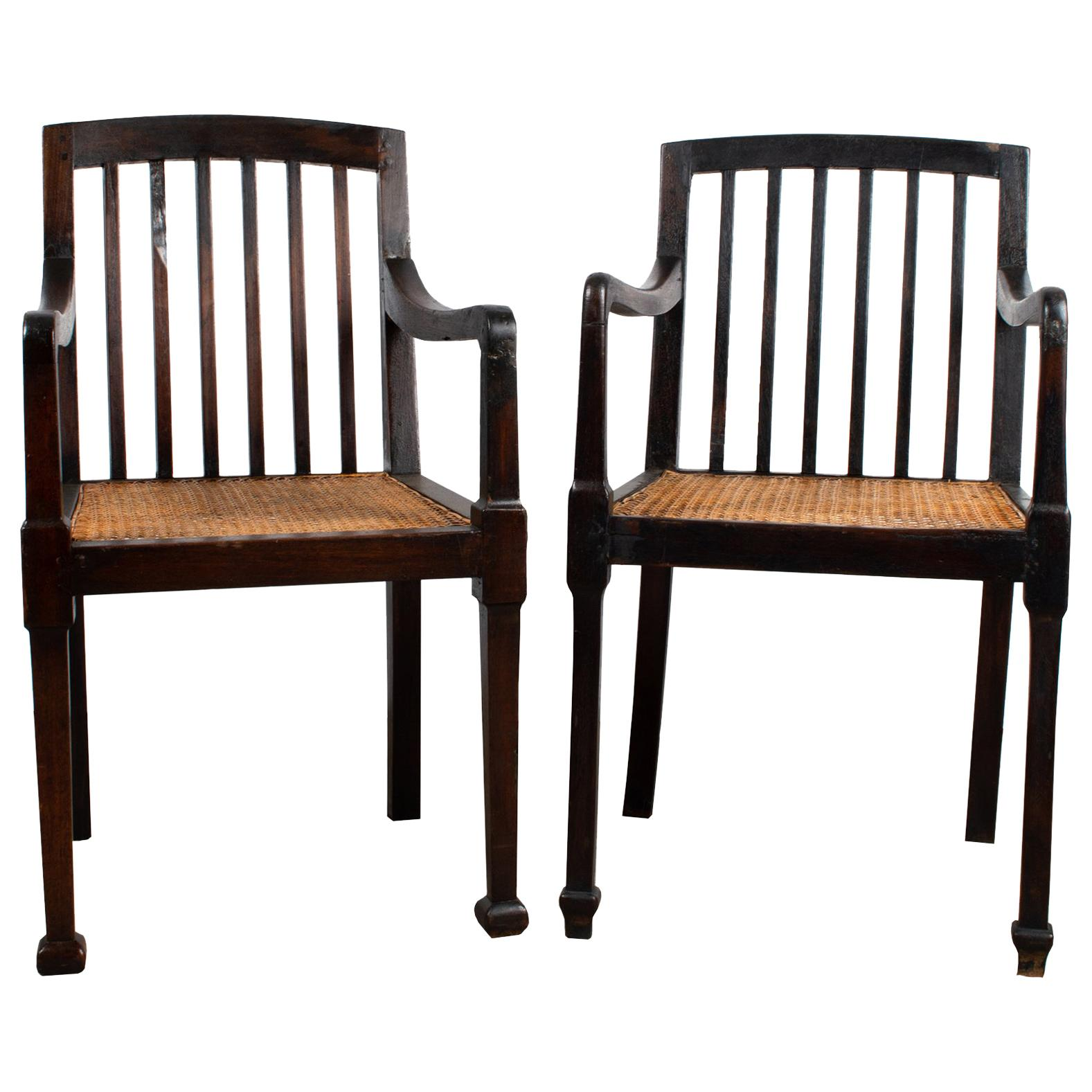 Pair of Antique British Colonial Teak and Rattan Hall Elbow Chairs, circa 1900