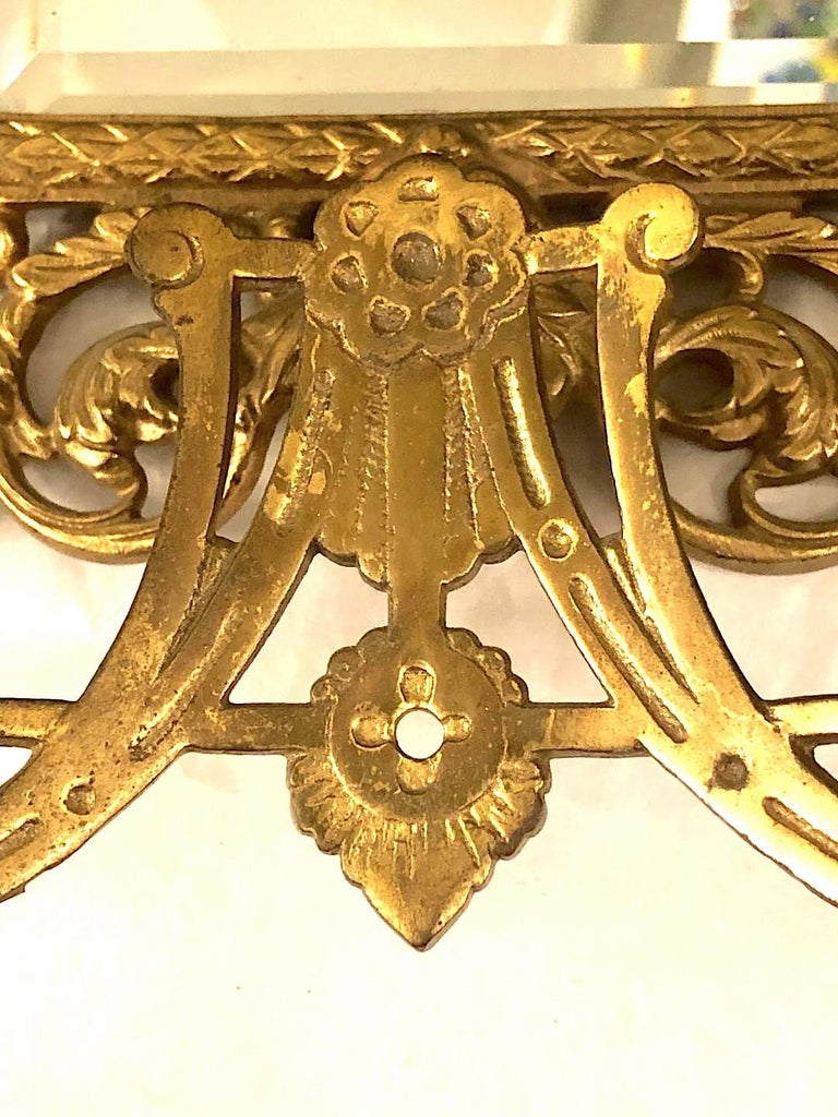 Gilt Pair of Antique Bronze Mirrored Sconces For Sale
