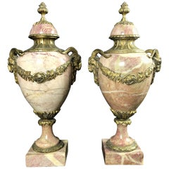 Pair of Antique Bronze Rams Head Mounted Pink and Beige Marble Cassolettes