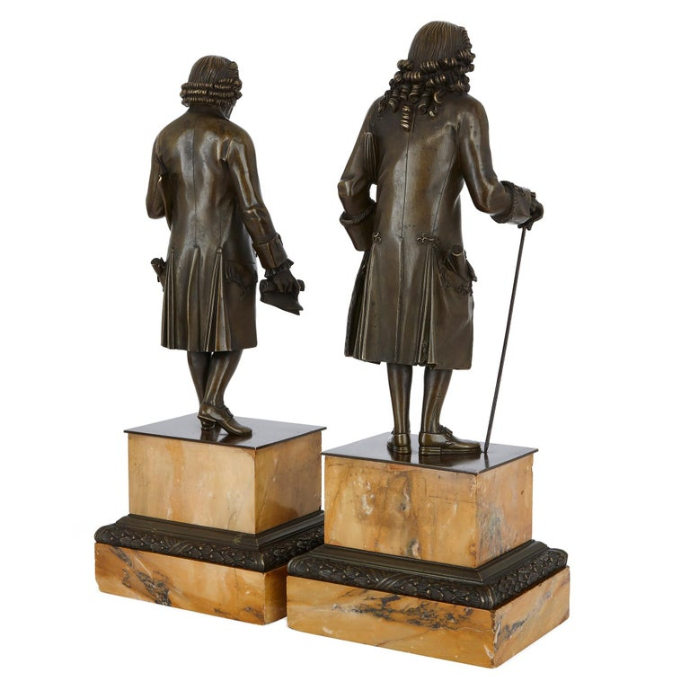 These fine bronze figures have been cast from bronze and patinated. They depict Jean-Jacques Rousseau (Swiss, 1712-1778) and Francois-Marie Arouet, who was better-known as Voltaire (French, 1694-1778). Rousseau and Voltaire were important