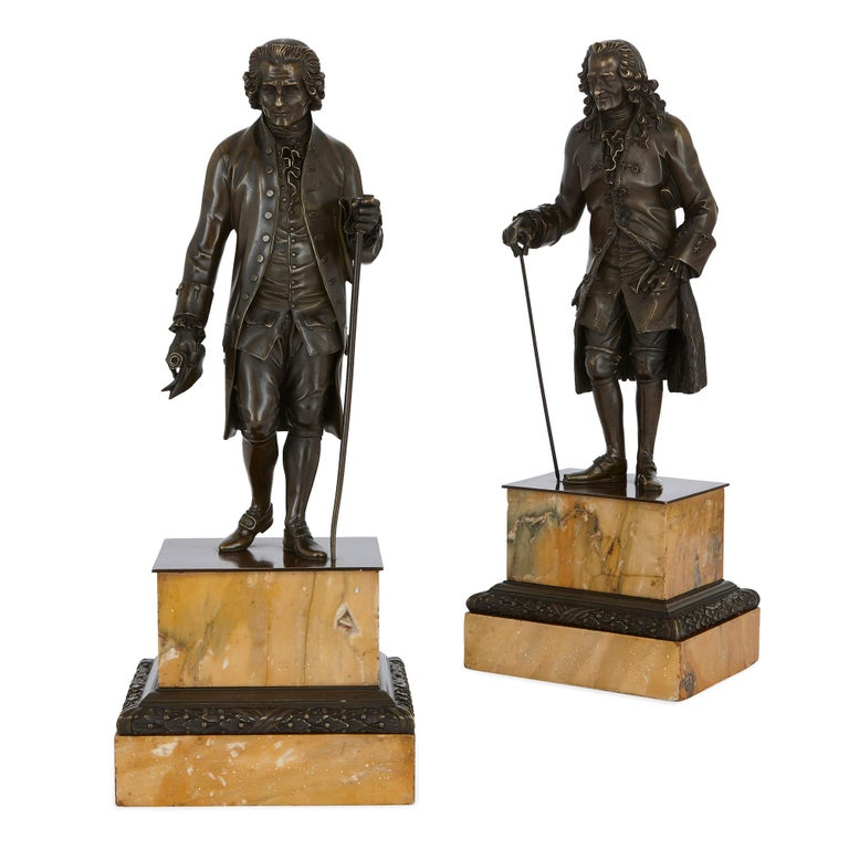 French Two Patinated Bronze Sculptures of Rousseau and Voltaire after Rosset For Sale