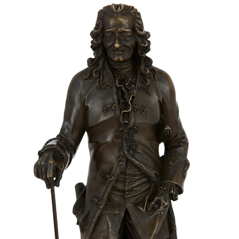 Two Patinated Bronze Sculptures of Rousseau and Voltaire after Rosset In Good Condition For Sale In London, GB