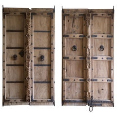 Pair of Antique Carved Teakwood and Iron Indian Doors