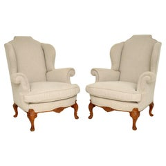 Pair of Antique Carved Walnut Wing Back Armchairs
