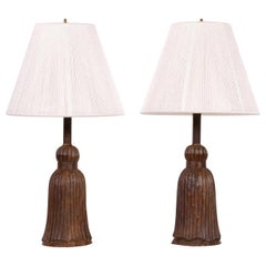 Pair of Antique Carved Wood Tassel Form Lamps