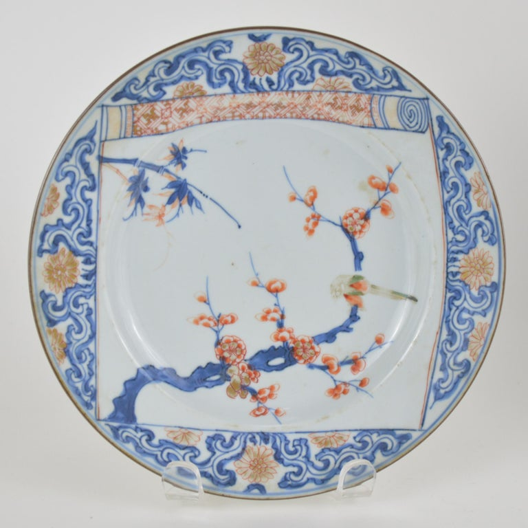 Pair of Chinese Imari plates, painted in underglaze-blue, red, and gold with various flowering branches, 18th century (Kanxi).