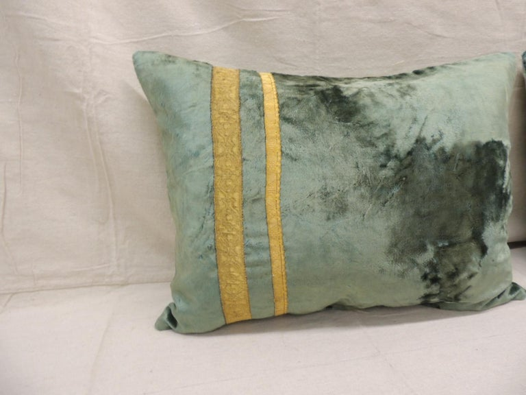 Pair of antique crushed velvet green and gold bolsters decorative pillows with 19th century metallic trims and aqua color silk backings. Decorative pillow handcrafted and designed in the USA.  Closure by stitch (no zipper closure) withcustom