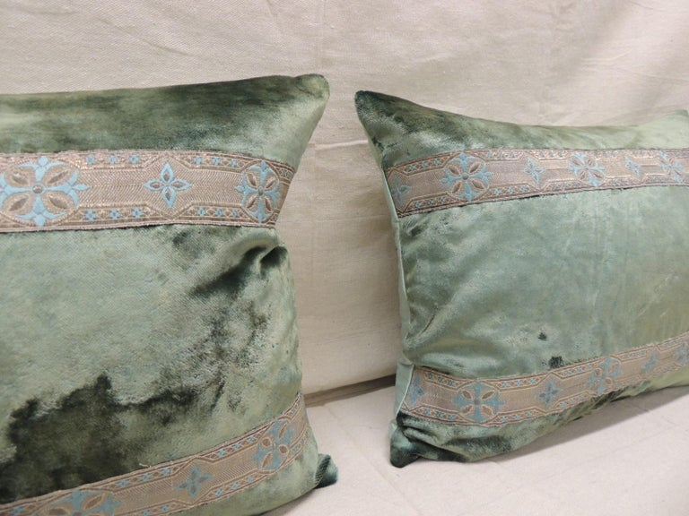 Pair of antique crushed velvet green and silver bolsters decorative pillows with 19th century metallic trims and aqua color silk backings. Decorative pillow handcrafted and designed in the USA. Closure by stitch (no zipper closure) with