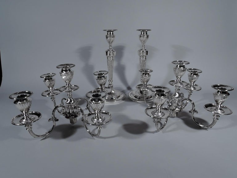 Pair of fine quality Edwardian sterling silver 5-light candelabra. Made by Hawksworth, Eyre & Co., Ltd in Sheffield in 1906. Each: Tapering shaft on spool base flowing into raised foot. Central baluster terminating in socket surrounded by 4