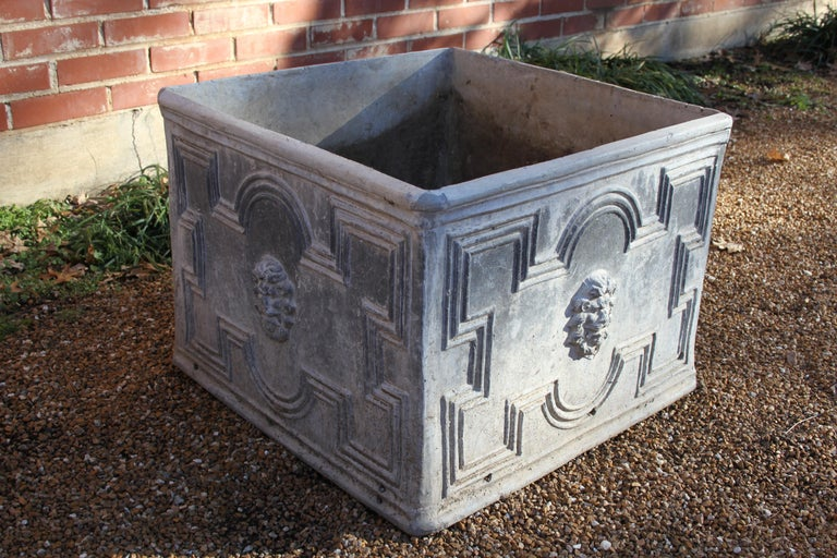 Antique lead planters with lions head and fantastic patina, from wonderful and elegant neoclassical home. These lead planters are very heavy, someone along the line drilled additional holes in sides, also there is some damage to some of the lion