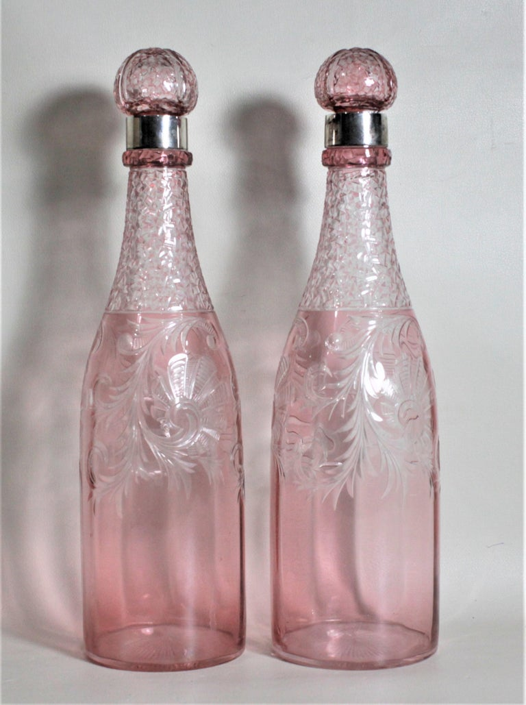 High Victorian Pair of Antique Pink Cranberry Cut Glass Bottle Decanters with Sterling Rims For Sale