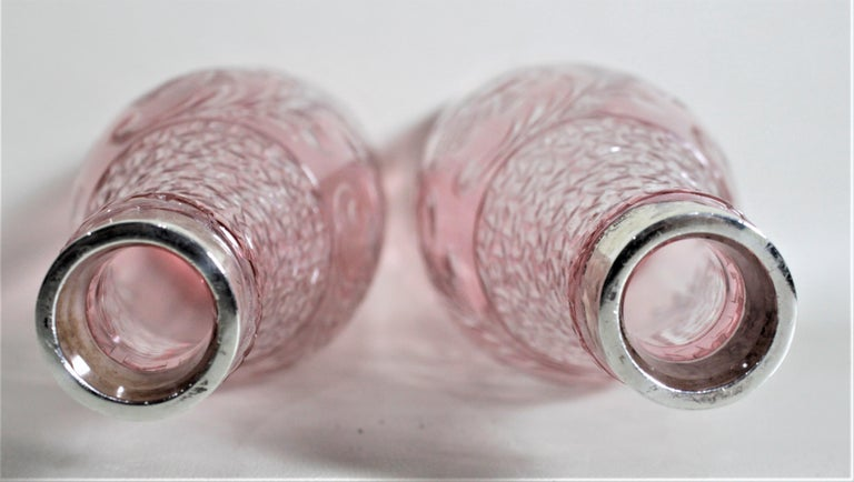 English Pair of Antique Pink Cranberry Cut Glass Bottle Decanters with Sterling Rims For Sale