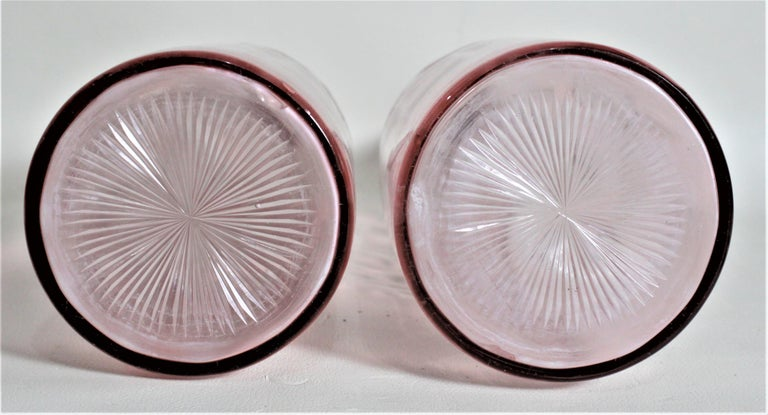 Hand-Carved Pair of Antique Pink Cranberry Cut Glass Bottle Decanters with Sterling Rims For Sale