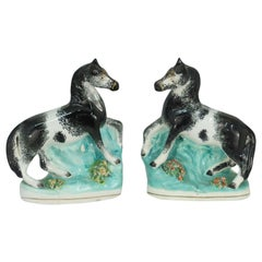Pair of Antique English Small Black and White Staffordshire Horses, circa 1850