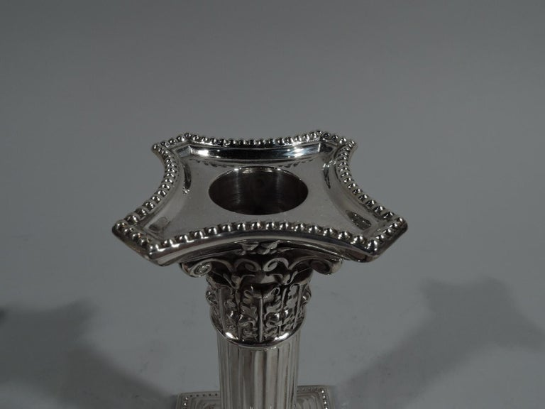 Neoclassical Pair of Antique English Sterling Silver Classical Column Candlesticks For Sale