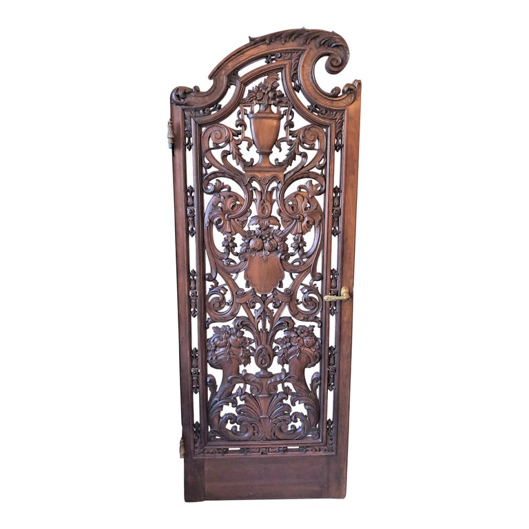 Pair of antique French carved walnut doors.