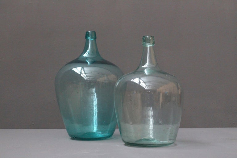 Lovely pair of French hand blown glass wine bottles from circa 1900.