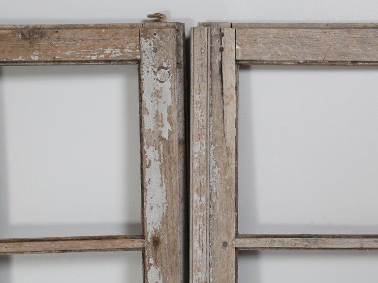 """Pair of original paint antique French doors, in as found condition and although the doors are in rough shape, they are very restorable and have """"great"""" original hardware."""