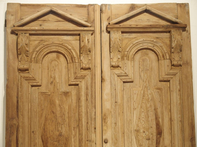 Neoclassical Pair of Antique French Egyptian Pine Doors with Carved Bird Motifs For Sale