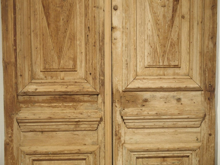 Hand-Carved Pair of Antique French Egyptian Pine Doors with Carved Bird Motifs For Sale