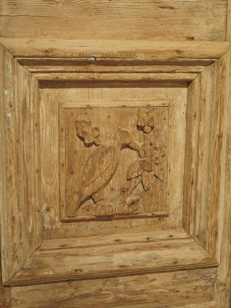 Pair of Antique French Egyptian Pine Doors with Carved Bird Motifs In Good Condition For Sale In Dallas, TX
