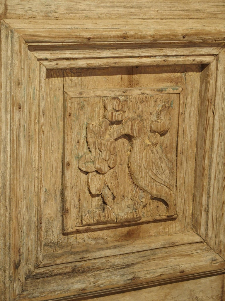 20th Century Pair of Antique French Egyptian Pine Doors with Carved Bird Motifs For Sale