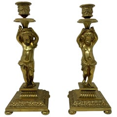 Pair of Antique French Gold Bronze Cupid Candlesticks, circa 1860-1870
