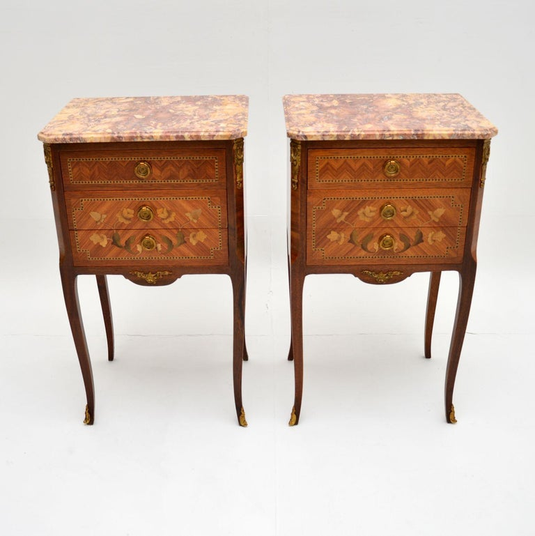 A stunning pair of antique French marble top chests on legs, which we would date from the 1900-1920's period.  They are of amazing quality and are very versatile. The backs are nicely polished, so these could be used as bedside chests or lamp