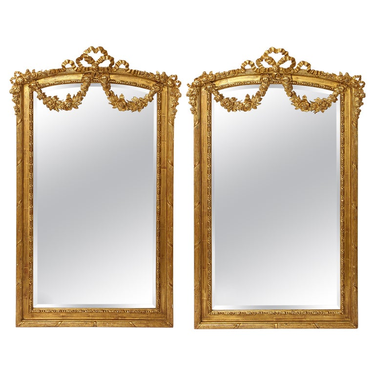 Pair of Antique French Louis XVI Style Hand Carved Giltwood Mirrors For Sale