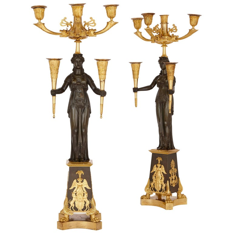 Pair of Antique French Patinated and Gilt Bronze Candelabra For Sale