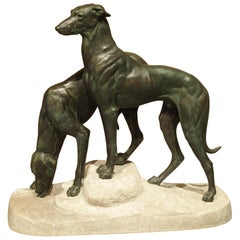Pair of Antique French Patinated Bronze Greyhounds on a Granite Base, circa 1920