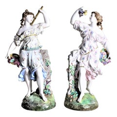 Pair of Antique German or Austrian Porcelain Female Figurines Harvesting Grapes