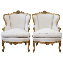 Pair of Antique Giltwood Linen Upholstered Bergère Chairs