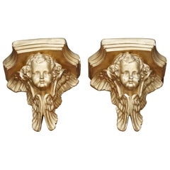 Pair of Antique Gold Leaf Painted Plaster Wall Sconces of Cherubs Nicely Cast