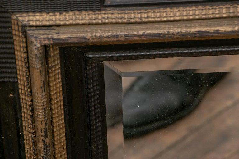 Rustic Pair of Antique Hand Carved, Ebonized and Gilt Frames Set with Mirrors For Sale