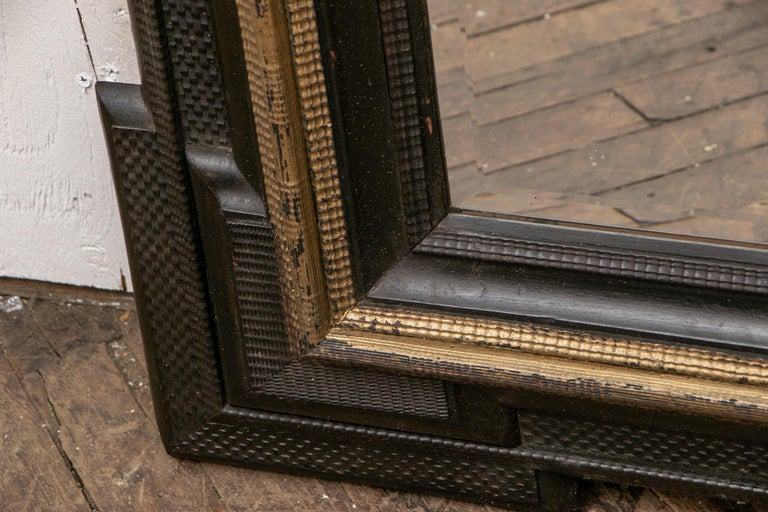 Pair of Antique Hand Carved, Ebonized and Gilt Frames Set with Mirrors In Good Condition For Sale In Bridgeport, CT