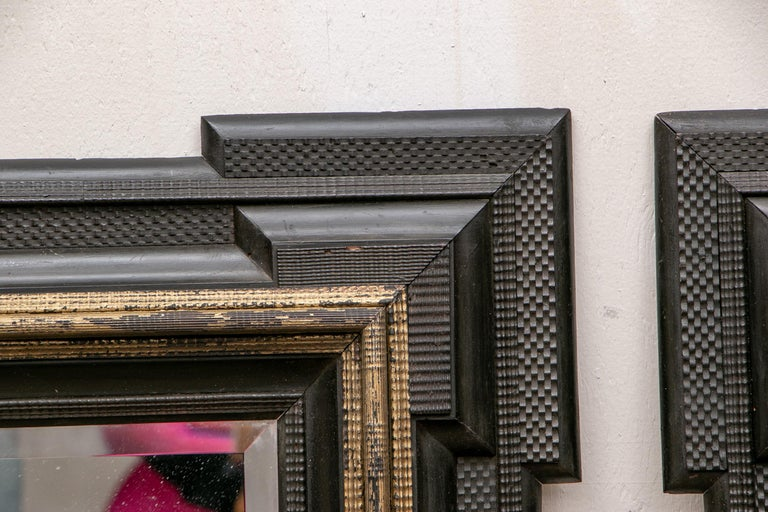 Wood Pair of Antique Hand Carved, Ebonized and Gilt Frames Set with Mirrors For Sale